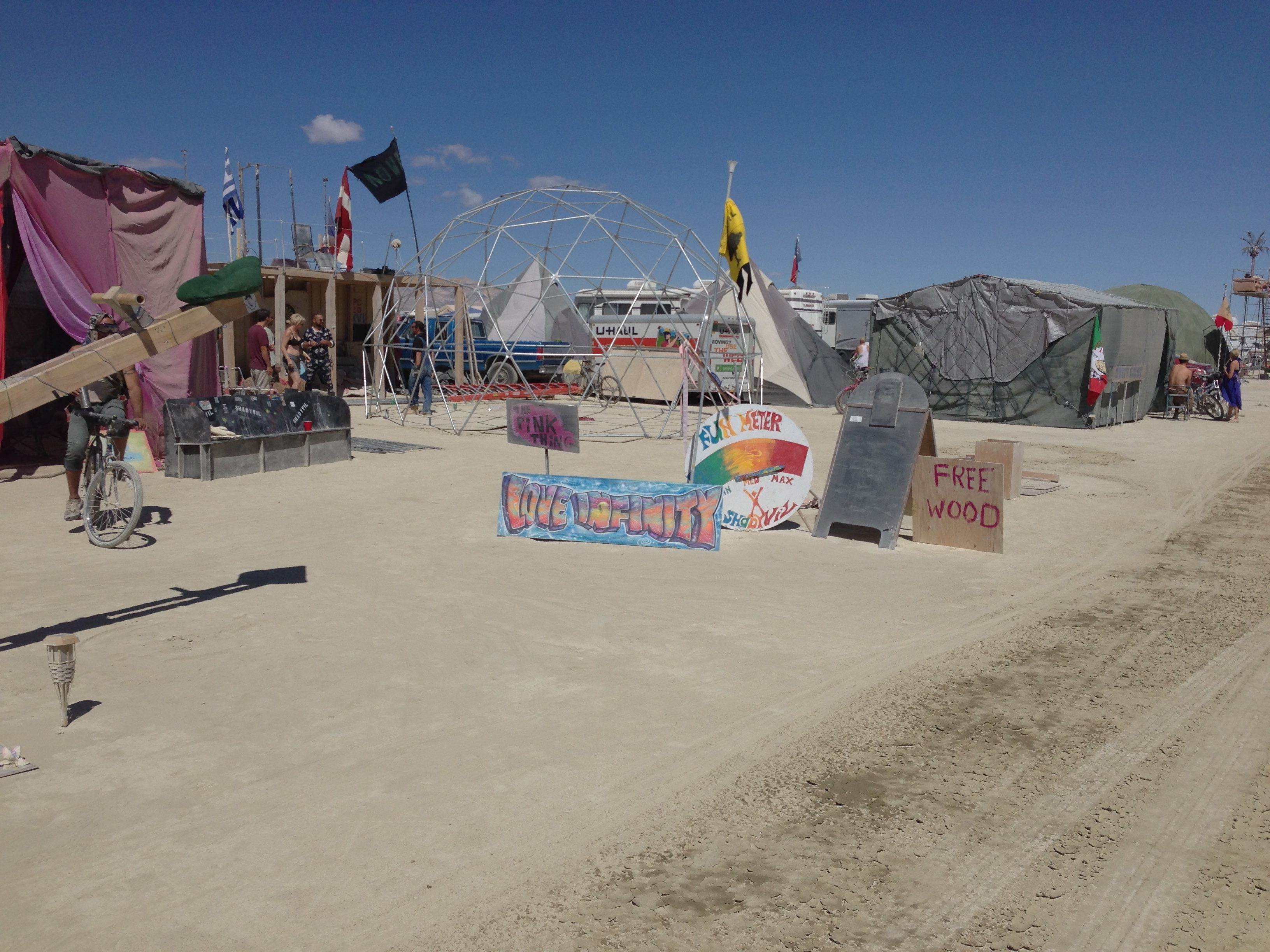 Somehow, this collection of signs seems to capture the essence of Burning Man.