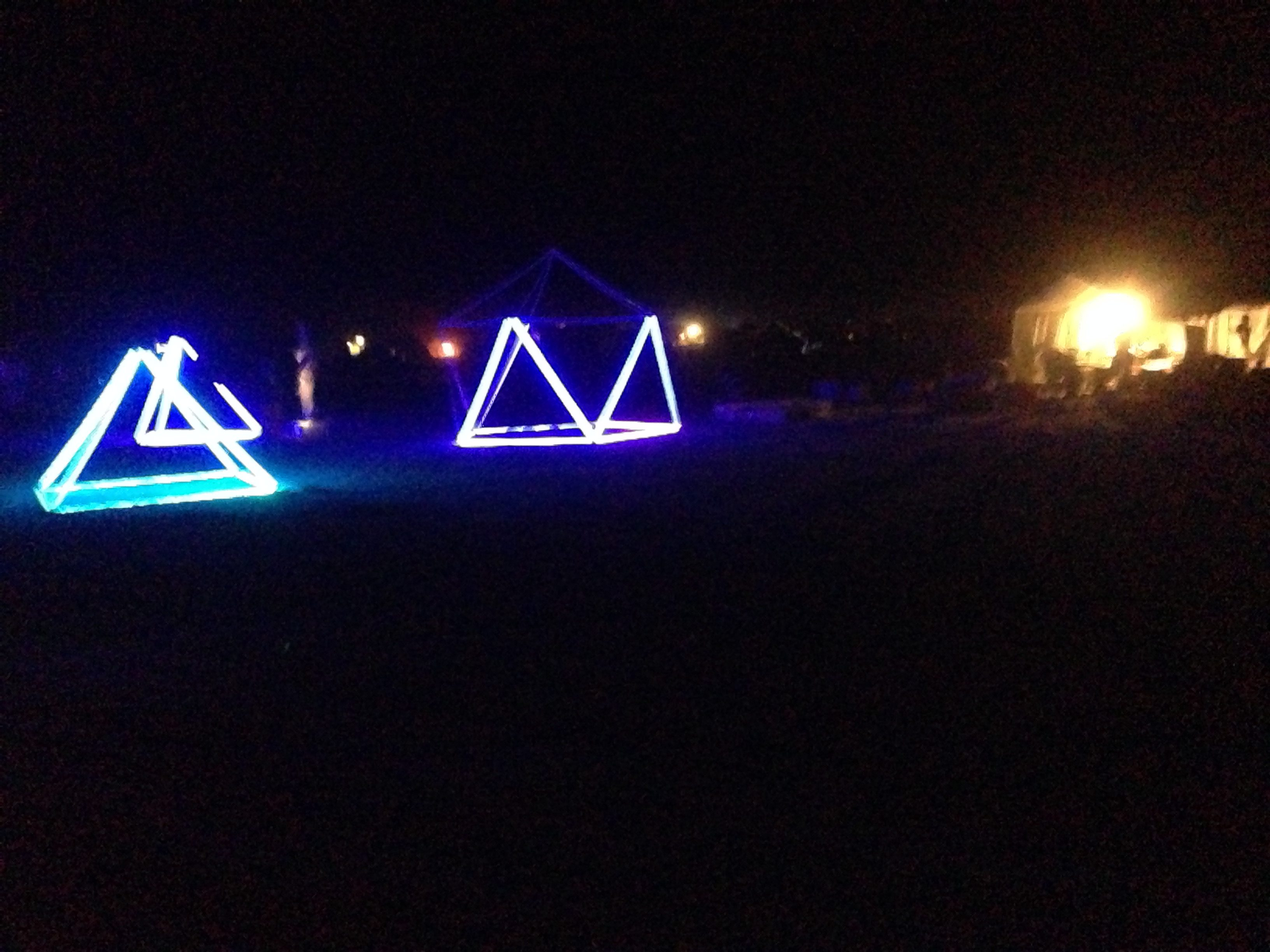 The tradition of geometric-shaped art cars continues.  Here we see the Square Pyramid and Projected Icosahedron.