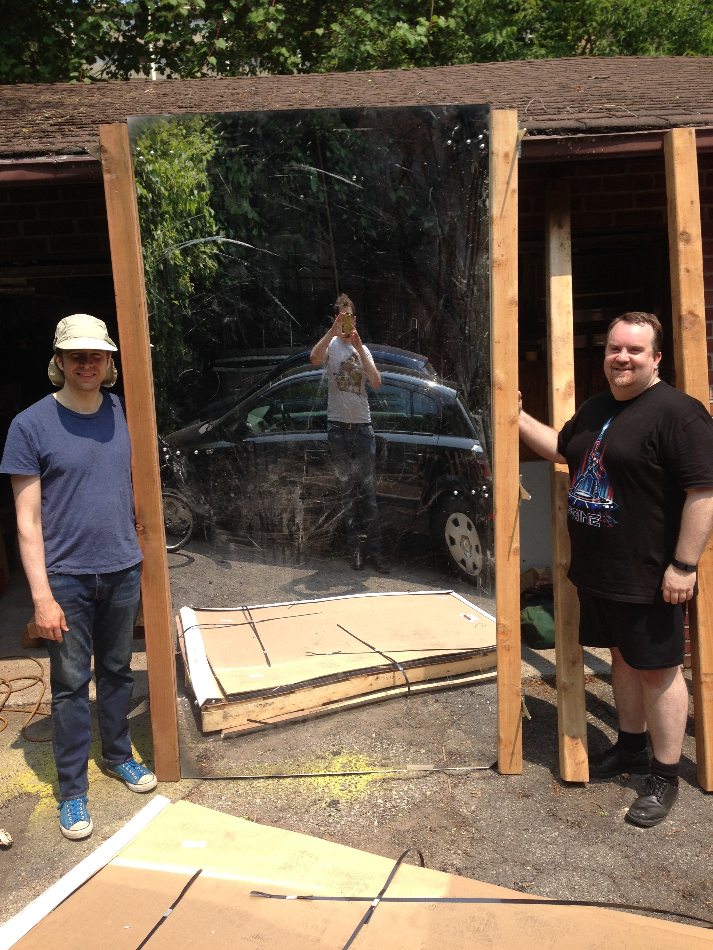 Geoff and Matt pose with their freshly constructed mirror panel!