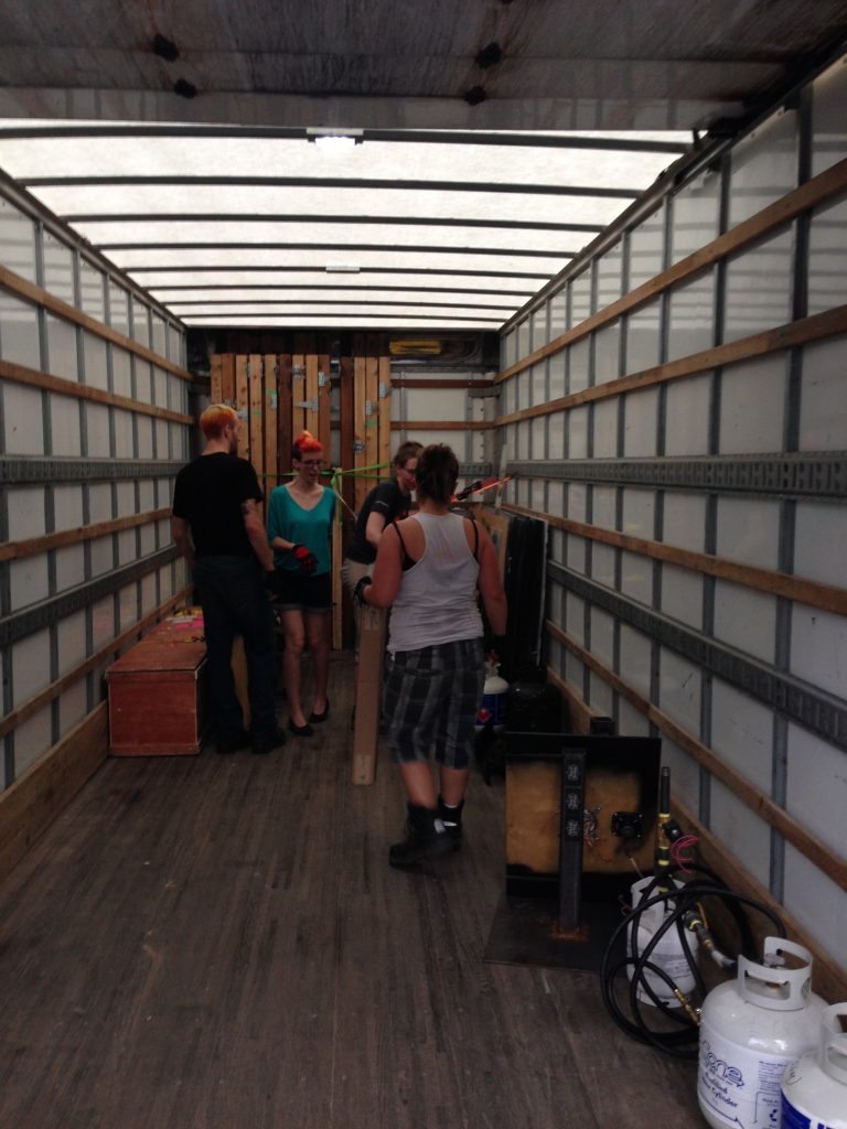 Mike, Sara, Carrie, and Trish have a confab about packing the truck.