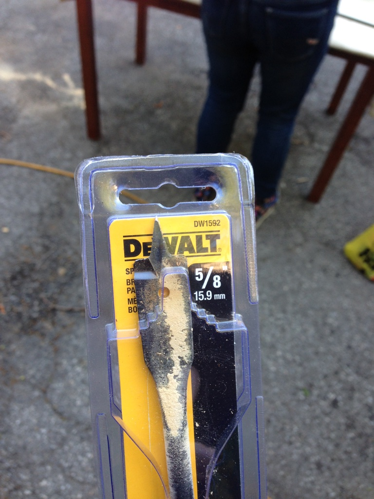 "We wore out a number of drill bits during this project.  Note the sawdust, and that this was an 18"" bit.  (And that we used a 5/8"" bit to drill out a hole for 1/2"" rebar.)"